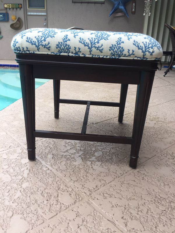 solid wood, fabric in excellent condition . Heavy solid piece!!! Bench seat or ottoman or side table -