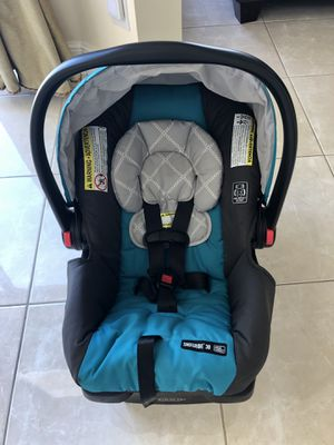 Graco SnugRide Infant Car seat in Sapphire Used once! Excellent like new condition! for Sale in Lake Worth, FL