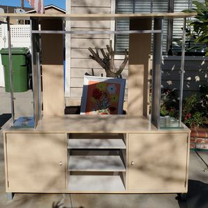 TV stand with glass shelves on the sides (not pictured set up) Lots of storage. for Sale in Whittier, CA
