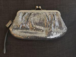 Coach silver sequin large wristlet clutch bag for Sale in Oakton, VA