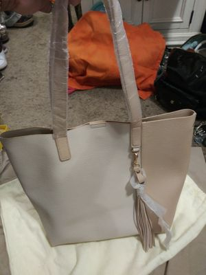 Really nice two-tone beige all leather brand new plastic Steel on the handles as well as tags really huge nice hobo size bag you can put a lot in it for Sale in Austell, GA