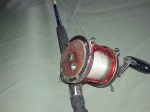 Deep sea fishing pole peen reel for Sale in Calexico, CA