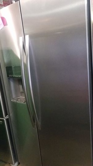 Whirlpool stainless steel side by side refrigerator excellent condition for Sale in Baltimore, MD