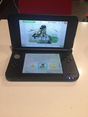 Nintendo 3ds xl with a charger and metal gear solid for Sale in Decatur, GA