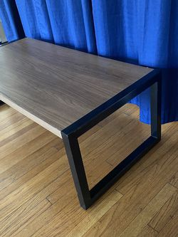 Mid century modern meets industrial coffee table or floor desk or a TV stand. Black Metal base. for Sale in Los Angeles,  CA