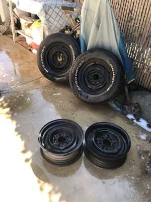 14 rims two 14 tires rollers 4.5 ford rims for Sale in Lawndale, CA