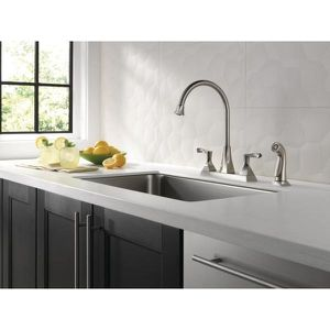 Everly 2-Handle Standard Kitchen Faucet with Spray in Stainless for Sale in Tacoma, WA
