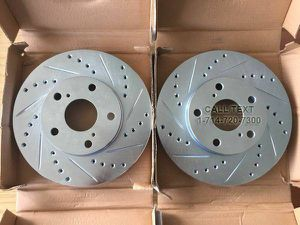 NEW DRILLED AND SLOTTED BRAKE ROTORS + CERAMIC PADS IN STOCK FOR MOST VEHICLES for Sale in Garden Grove, CA