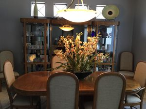 Dining room table with extra leaf and table pads. 8 chairs 2 lighted curio cabinets connected by light bridge. They all light up for Sale in Sarasota, FL