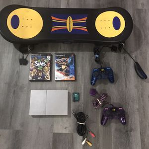 PS2 Slim w Games, Controlllers, and Skateboard Controller for Sale in Surprise, AZ