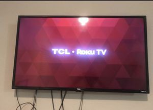 Tcl roku tv 40 inch .. with wall mount panel / tv stand for Sale in Charlotte, NC