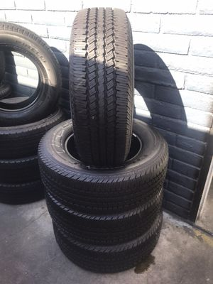 SET OF FOUR CONTINENIAL LT 275/65/18 SEMI NEW 95 TREAD LIFE $400 INCLUDING LABOR. for Sale in Fullerton, CA