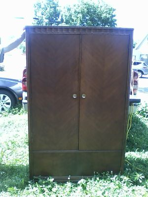 Wood armoire wardrobe cabinet for Sale in Kirkersville, OH
