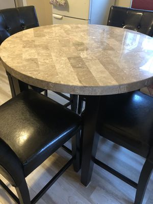 Dining table with granite and 4 leather Chairs for Sale in Willows, CA
