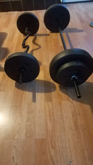 2x25lbs 2x15lbs 2x10lbs 5 foot barbell and a 4 foot curling barbell for Sale in Montebello, CA