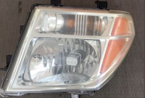OEM Nissan Frontier Driver Side head light assembly for Sale in Spring Hill, FL