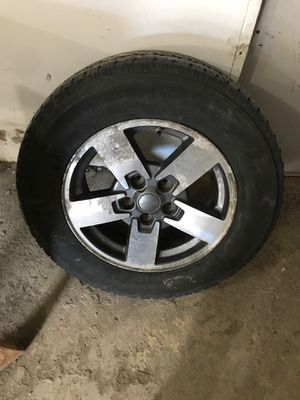 Jeep commander wheel and tire for Sale in Dearborn Heights, MI