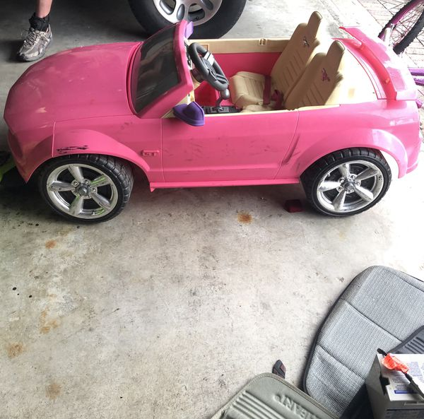 POWER WHEELS—Barbie Mustang. Includes New Battery (In Box-Never Used) and charger. Garage kept. Great condition.