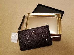 Coach F38641 Black/ Slvr Smll Wristlet Star Glitter. Gold Gift Box Included NWT. Condition is New with tags. for Sale in Germantown, MD
