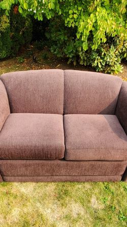 Purple love seat sofa stored inside and covered. Good condition. for Sale in Lake Stevens,  WA
