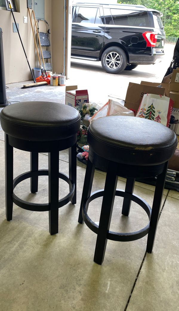 Two spinning bar stools