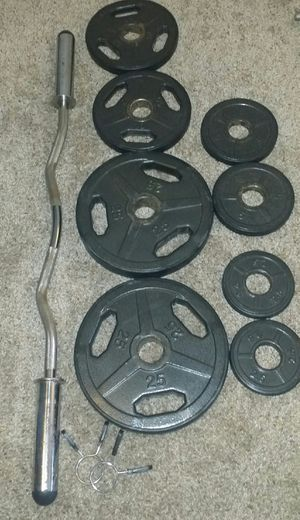 "Olympic 2"" weights with rubber around them. 2x25lbs, 2x10lbs, 2x5lbs, 2x2.5lbs. Olympic curl bar with 2 weight locks. for Sale in Deerfield Beach, FL"