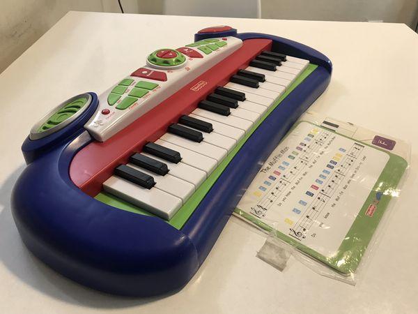 FisherPrice kidtronics Rockin' Keyboard with sheet music