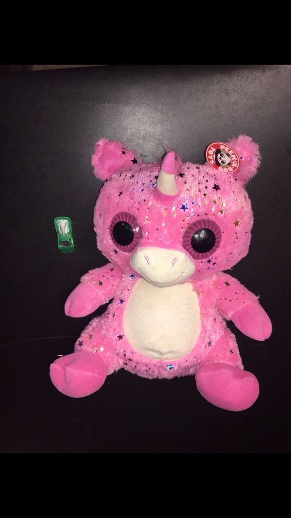 Giant fluffy pink unicorn creature plush