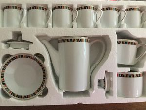 Extra small set of cups, saucers etc... never used... Great for expresso or other beverages..I small coffee pot, sugar, and creamer holder $15 for Sale in Peoria, AZ