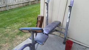 Weight bench curl bar bunch of weight for Sale in Kennewick, WA