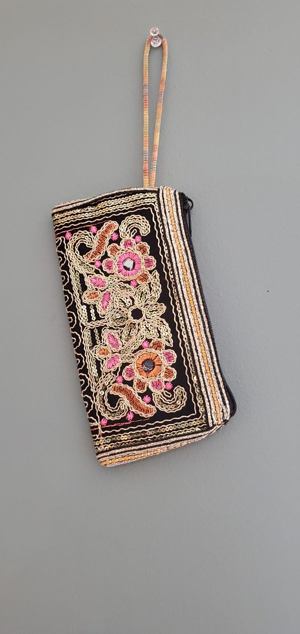 Embroidered clutch.