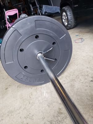 7 ft Standard bar with 50 pounds of weight for Sale in Columbus, OH