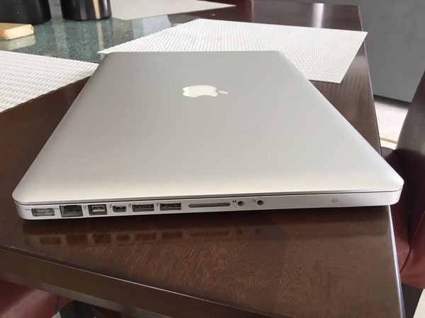 15inch i7 MacBook Pro comes with water resistant laptop bag and 60w charger