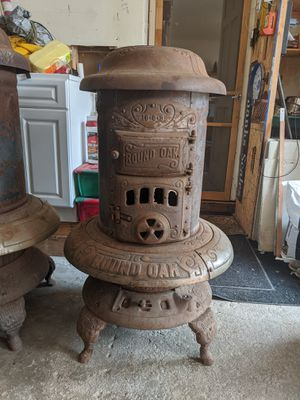 Round Oak 16-0-3 wood burning stove for Sale in St. Charles, IL