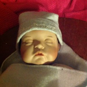 Porcelain Disney Babies baby boy wrapped with little hat for Sale in Louisville, KY
