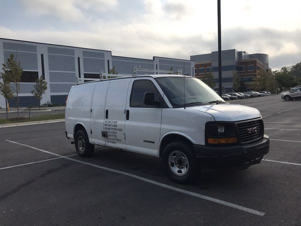 2007 Chevrolet express cargo van with 98,000 miles runs and drives great ice cold AC new tires triple ladder rack double sided work shelves ready for