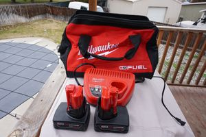 Milwaukee m12 4ah Batteries with m12 C harger and General Contractor Bag for Sale in Kennewick, WA