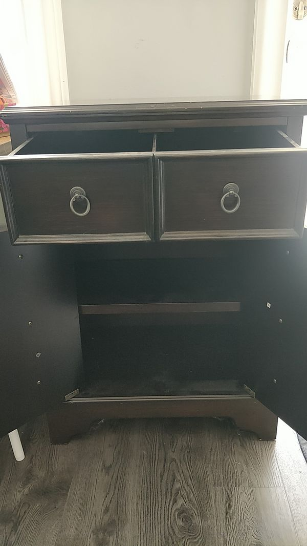 Nightstand with pull out drawers and doors