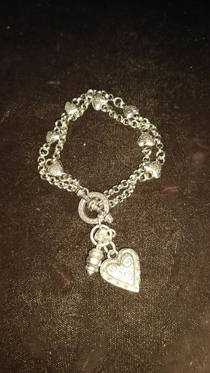 Silver charm bracelet with hearts on band and one large heart for Sale in Dallas, TX