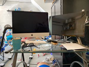 Glass work desk with attached shelving for Sale in Ashburn, VA