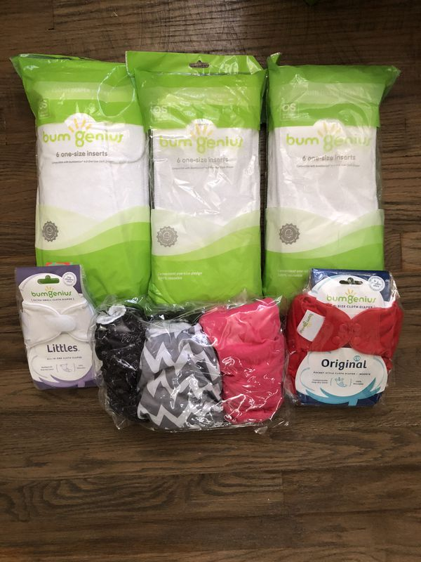 Cloth diapers. Bum Genius. A few open, but never used. 4 size adjustable, and one newborn. 3 packs of diaper liners.