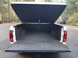Hard tonneau cover for Silverado or Sierra truck bed with rug for Sale in Lacey, WA