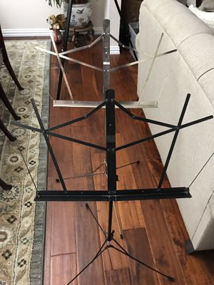 2 Music stands / black with bag and stainless with no bag for Sale in Allen, TX