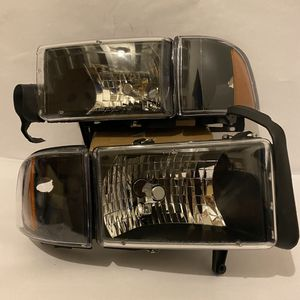 94-01 Dodge Ram 1500 2500 3500 clear with black housing headlights for Sale in Huntington Park, CA