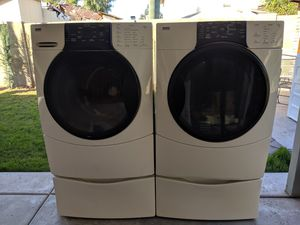 Kenmore washer and electric dryer with pedestals for Sale in Glendale, AZ
