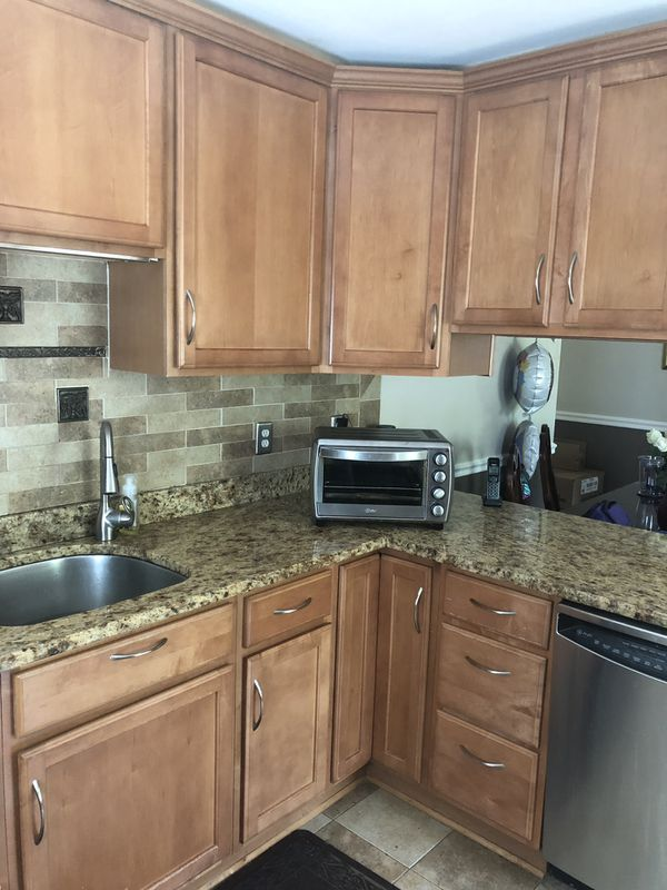 Kitchen cabinets with granite, stove ,microwave and dishwasher