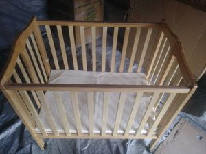 Foldable baby crib and diapers 15 packs of diapers for 35 lb$225 for Sale in Chicago, IL