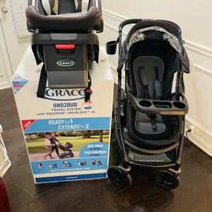 Graco Uno2Duo Travel System | Includes UNO2DUO Stroller and SnugRide SnugLock35 Infant Car Seat, Goes from Single to Double Stroller for Sale in Cumming, GA