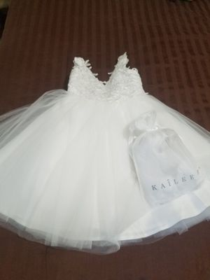 Flower girls dress and sandal. Selling dress white color and with sandals, brand new , dress is size 5 the dress runs big, sandals size 12 for Sale in Hollywood, FL