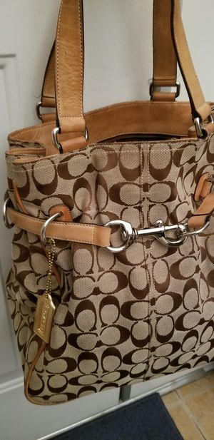 Handbag by Coach. Used good condition. $22Canvas & leather.Style Belted Carryall Tote.Clean just has some Use, can be nicely cleaned w Leather cleaner for Sale in Las Vegas, NV